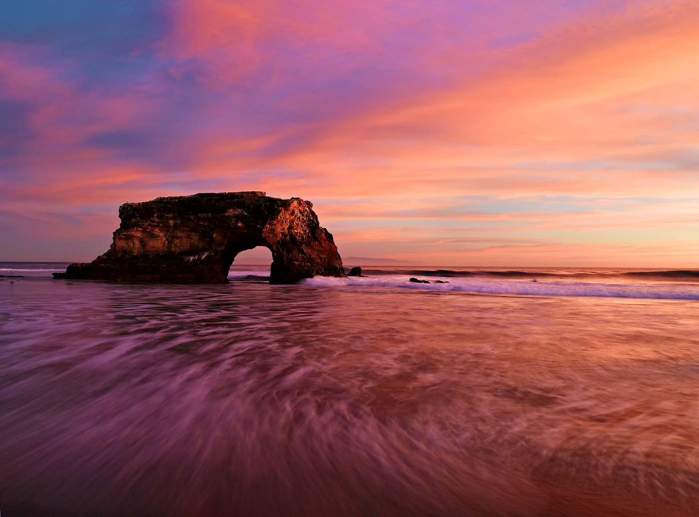 Sunset at Natural Bridges State monument in Santa Cruz, California.