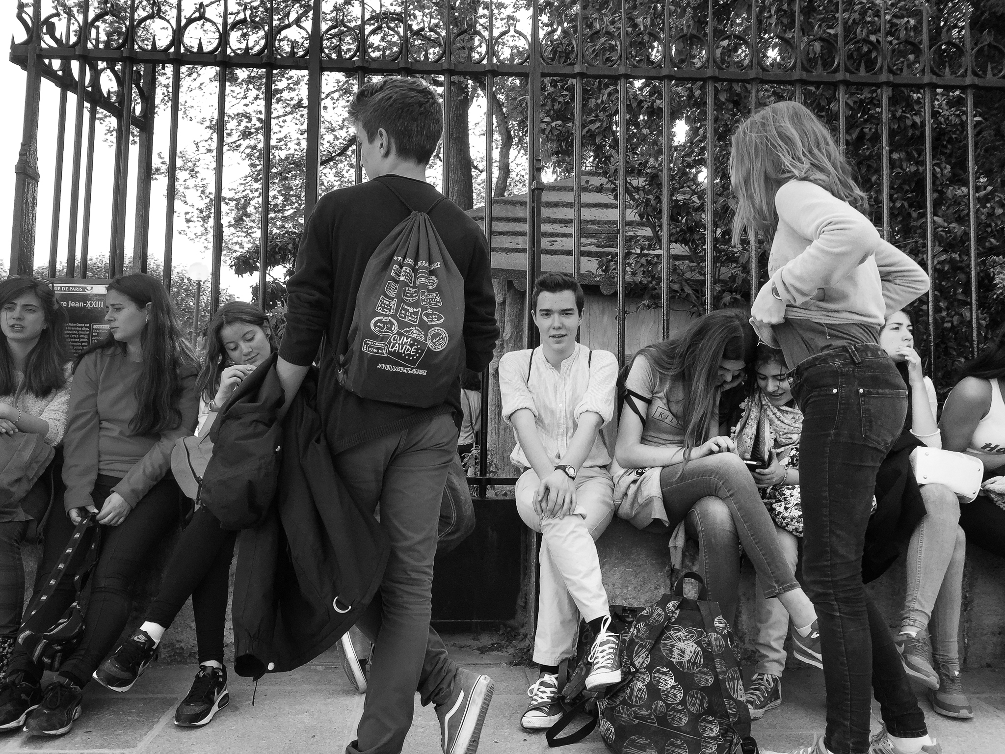 School friends congregate outside a park in Paris, France.