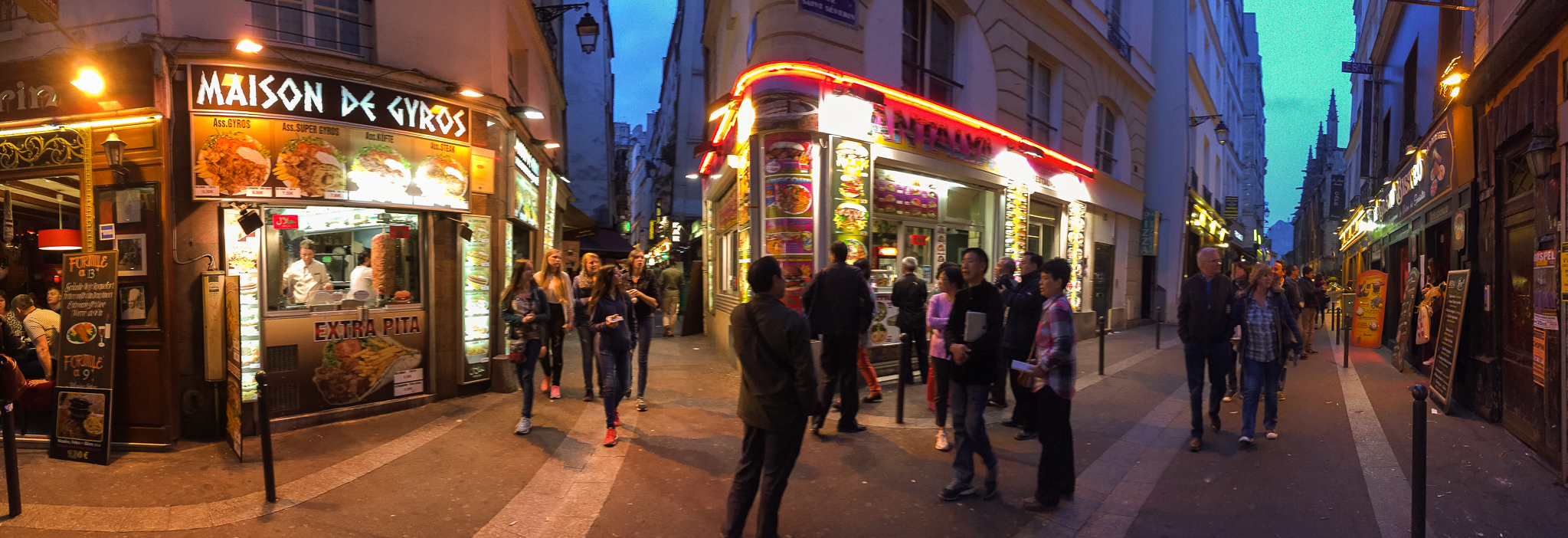 Tourists mix with Parisians on the streets of the Latin Quarter in Paris, France.